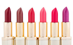 Multicolored color lipsticks arranged in line Stock Photos