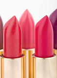 Multicolored color lipsticks arranged in two lines Royalty Free Stock Photo