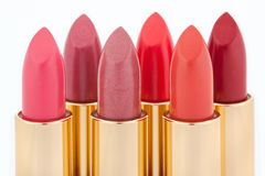 Multicolored color lipsticks arranged in two lines Stock Photo