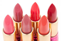 Multicolored color lipsticks arranged in two lines Royalty Free Stock Photos