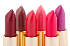 Multicolored color lipsticks arranged in two lines Stock Images