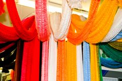 Multicolored colored bright motley pieces of bundles samples of colored artificial acrylic fabric, fibers, demonstration royalty free stock images