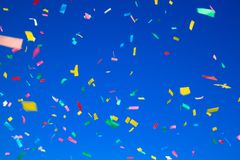 Free Multicolored Confetti On Clear Blue Sky Background. Concept Of H Royalty Free Stock Photo - 118308065