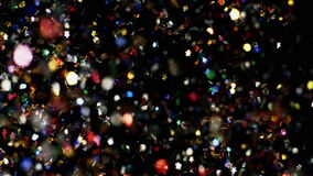 Multicolored confetti particles flying being exploded colorful stars and hearts bouncing slow motion. Multicolored confetti flying after being exploded, colorful stock video footage