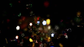 Multicolored confetti particles flying being exploded colorful stars and hearts bouncing slow motion. Multicolored confetti particles flying after being exploded stock video