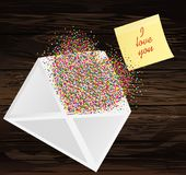A multicolored confetti in the shape of a heart flies out of the. Envelope.Yellow sheet of paper for notes. Sticke with word i love you. A greeting card or an Royalty Free Stock Image