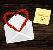 A multicolored confetti in the shape of a heart flies out of the. Envelope. Yellow sheet of paper for notes. Sticker. A greeting card or an invitation to a Stock Images