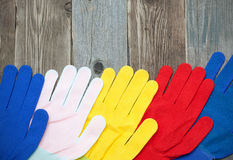 Multicolored construction gloves Stock Image