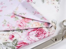 Multicolored cotton fabric. Cloth from cotton for sewing clothes. And bedding. Satin is stacked. Many textiles for sewing. Cotton fabric with a different Royalty Free Stock Photos