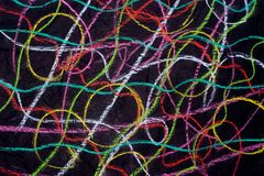 Multicolored crayon doodles on black paper Royalty Free Stock Photo