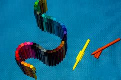 Crayons isolated on blue background royalty free stock images