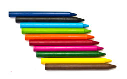 Multicolored crayons on white background. Royalty Free Stock Photography
