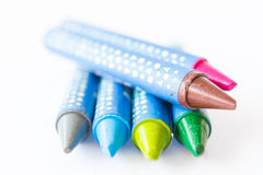 Multicolored crayons on a white background Royalty Free Stock Images