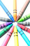 Multicolored crayons on a white background Royalty Free Stock Image