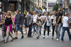 A multicolored crowd walks along Carnaby Street. Carnaby Street is one of the main shopping streets of London. LONDON, ENGLAND - August 11 2017 A multicolored Stock Photography
