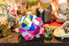 Multicolored cube in origami technique in Kyoto, Japan. Close-up royalty free stock image