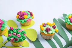 Multicolored cupcakes with decoration like indoor plants succulents stock photo