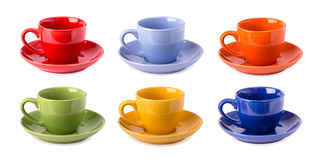 Multicolored cups isolated Stock Images