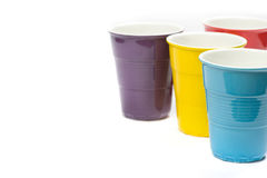 Multicolored cups Stock Images