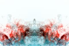 Multicolored curling smoke, red blue vapor, curled into abstract shapes and patterns on a white background, repeating the movement. Of waves and a chemical royalty free stock image