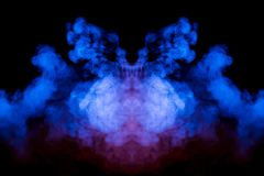 Multicolored curling smoke rising upwards in a pillar, pink blue vapor twisting into abstract shapes and patterns on a black stock photos