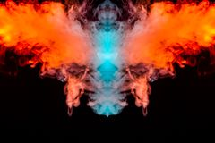 Multicolored curling smoke rising upwards in a pillar, red blue vapor twisting into abstract shapes and patterns on a black royalty free illustration