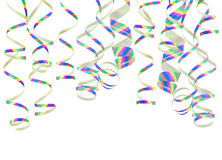 Multicolored curling stream paper strands Royalty Free Stock Images