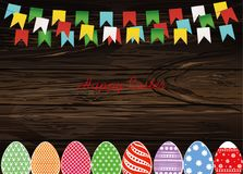Multicolored decorated Easter eggs. Garland of flags. Bunting. G. Reeting card or invitation for a holiday. Vector on wooden background. Empty space for text Royalty Free Stock Photos