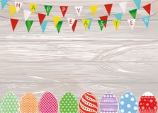 Multicolored decorated Easter eggs. Garland of flags. Bunting. G. Reeting card or invitation for a holiday. Vector on wooden background. Empty space for text Royalty Free Stock Photography