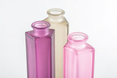 Multicolored Decorative Bottles. On a white background Royalty Free Stock Photography