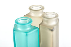 Multicolored Decorative Bottles. On a white background Royalty Free Stock Photos