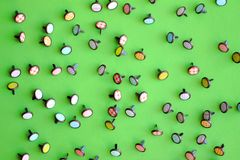 Multicolored decorative buttons for clothes on a green background pattern stock photo