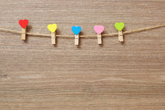 Multicolored decorative clothespins with a heart Royalty Free Stock Images