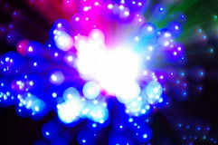Multicolored decorative fiber glass lamp. Holiday multicolored stars sparkler closeup Royalty Free Stock Photos