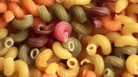 Multicolored deegwaren als achtergrond stock video