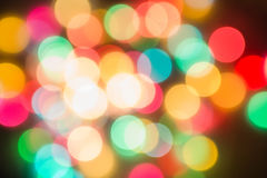 Multicolored defocused bokeh blurry lights. Christmas lights, festive background Royalty Free Stock Photo