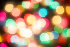 Multicolored defocused bokeh blurry lights. Christmas lights, festive background Royalty Free Stock Images
