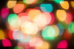 Multicolored defocused bokeh blurry lights. Christmas lights, festive background Stock Photography