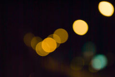 Multicolored defocused bokeh lights at Night for background or texture.  Stock Photos