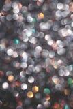 Multicolored defocused shiny confetti stock images