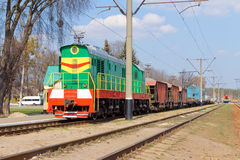 The multicolored diesel train on the rails Royalty Free Stock Photos