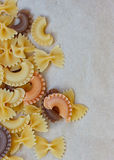 Multicolored different shapes of uncooked pasta Stock Photos