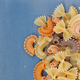 Multicolored different shapes of uncooked pasta Stock Photography