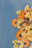 Multicolored different shapes of uncooked pasta Royalty Free Stock Photography