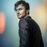 Multicolored digital painted image portrait of elegant young handsome man. Stock Photography