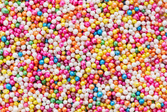 Multicolored  dragee balls background Stock Photography