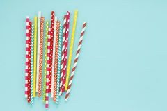 Multicolored drinking straws on cyan background. Royalty Free Stock Photo