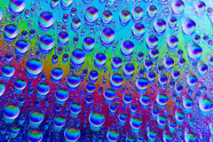 Multicolored drops of water Royalty Free Stock Photo