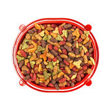 Multicolored dry cat or dog food in red bowl isolated on white background Stock Photos