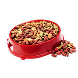 Multicolored dry cat or dog food in red bowl isolated on white Stock Photos